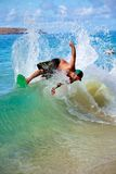 Skimboarding at Big Beach. A man skimboarding at Big Beach in Maui Hawaii. Skimboarding originated in Southern California when lifeguards wanted an easy way to Royalty Free Stock Photos