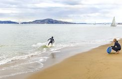 Skimboarding in San Francisco Bay, California Immagini Stock