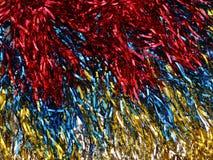 Skimra skinande kulör julgranglitterbakgrund Arkivfoto