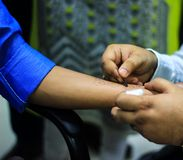 skin allergy test preparation by doctor on a patient hand using lancet to the skin royalty free stock images