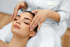 Skin, Body Care. Woman Getting Beauty Spa Face Massage. Treatmen Royalty Free Stock Images