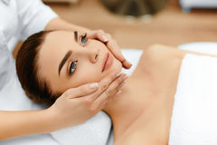 Skin, Body Care. Woman Getting Beauty Spa Face Massage. Treatmen Stock Images
