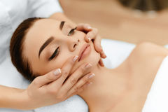 Skin, Body Care. Woman Getting Beauty Spa Face Massage. Treatmen Stock Photography