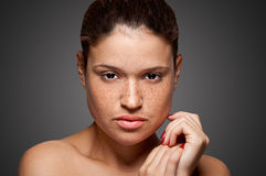 Skin care. Portrait of young woman isolated on grey background Royalty Free Stock Image