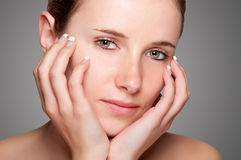 Skin care. Portrait of young woman on a grey background Stock Image