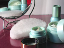 Skin Care. Products reflected in mirror royalty free stock photography