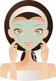 Skin care. Beautiful Brunette Caucasian Woman With Green Eyes, Facing Front And Touching The Green Facial Mask On Her Face