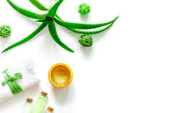 Skin care. Aloe vera gel and aloe vera leafs on white background top view copyspace Royalty Free Stock Images
