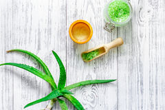 Skin care. Aloe vera leafs and spa salt on wooden background top view copyspace Stock Image