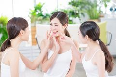 Skin care asian women friend. Asian women friend are talking about thier healthy skin and teeth stock photography