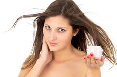 Skin care, beautiful girl with cream Royalty Free Stock Photos