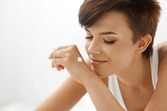 Skin Care. Beautiful Happy Woman With Hand Cream Lotion On Hands Stock Photos
