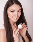 Skin Care. Beautiful healthy young woman with long hair, caring for their skin. Use cream for body care. Beauty and health Stock Images
