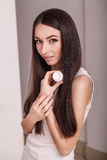 Skin Care. Beautiful healthy young woman with long hair, caring for their skin. Use cream for body care. Beauty and health Stock Photo