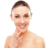 Skin care. Beautiful young woman checking her face skin and looking for blemishes Royalty Free Stock Photo