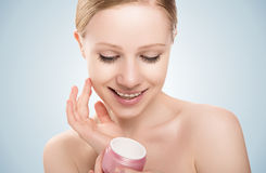 Skin care.  beauty  girl with eyes closed with jar of cream Royalty Free Stock Photography