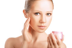 Skin care.  beauty healthy girl with jar of cream isolated on wh Royalty Free Stock Image