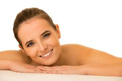 Skin care - beauty portrait of cute caucasian woman lying on tab royalty free stock images