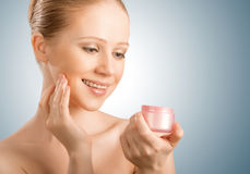Skin care.  beauty  woman with eyes closed with jar of cream Stock Photos