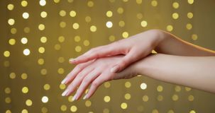 Skin care and body. Concept of beauty, hygiene, skin care and body. Closeup of applying cosmetic cream to female hands stock video