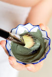 Skin care. Closeup of brush and clay mud mask. Stock Photography