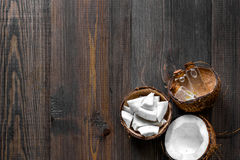 Skin care. Coconut lotion on wooden table background top view copyspace Stock Image