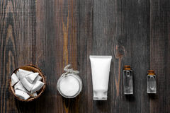 Skin care. Coconut oil, cream and lotion on wooden table background top view copyspace Royalty Free Stock Photo