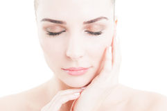 Skin care concept with female model face wearing daytime make-up. And eyes closed on white background Stock Images
