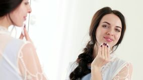 Skin care every day routine, woman applying cleanser tonic for deep cleaning and fresh skin stock footage