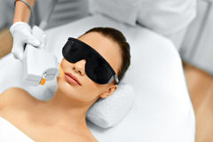 Skin Care. Face Beauty Treatment. IPL. Photo Facial Therapy. Ant. Skin Care. Young Woman Receiving Facial Beauty Treatment, Removing Pigmentation At Cosmetic stock images