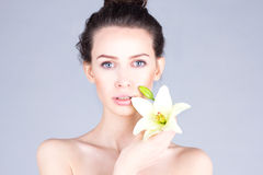 Skin care. Face of woman with lily. SPA and beauty. Royalty Free Stock Photos