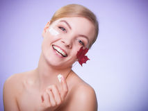 Skin care. Face of young woman girl with red maple leaf. Royalty Free Stock Image