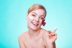 Skin care. Face of young woman girl with red maple leaf. Royalty Free Stock Photo