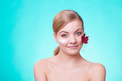 Skin care. Face of young woman girl with red maple leaf. Royalty Free Stock Images