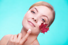 Skin care. Face of young woman girl with red maple Stock Photos