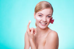 Skin care. Face of young woman girl with red maple Stock Images