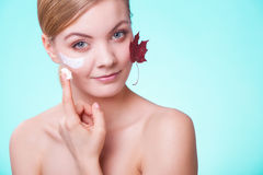 Skin care. Face of young woman girl with red maple Royalty Free Stock Images
