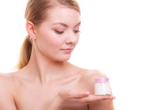 Skin care. Girl applying moisturizing cream. Royalty Free Stock Image