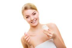 Skin care. Girl applying moisturizing cream. Stock Photo