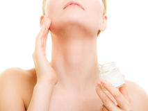 Skin care. Girl applying moisturizing cream Royalty Free Stock Image