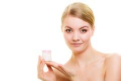 Skin care. Girl applying moisturizing cream. Stock Photography