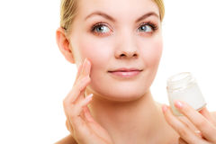 Skin care. Girl applying moisturizing cream. Royalty Free Stock Photography