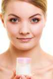 Skin care. Girl applying moisturizing cream. Royalty Free Stock Photo