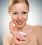 Skin care. happy beauty healthy girl with jar of cream Stock Images