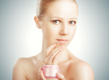 Skin care. happy beauty healthy girl with jar of cream Stock Photo