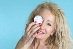Skin care - mature woman cleaning her face Royalty Free Stock Photo