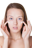Skin care. Portrait of a natural looking womn with moisturazer Stock Image