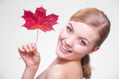 Skin care. Portrait of young woman girl with red m Royalty Free Stock Photo
