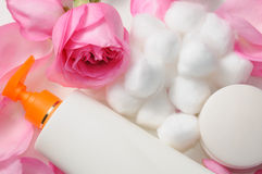 Skin care products. Blank skin care lotion with rose petals and cotton swabs stock photography
