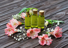 Skin care products and pink flowers Royalty Free Stock Photography